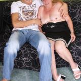 Naughty granny Simone fools around with a young hottie and gives him a taste of her cock sucking and fucking